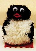 Mignon petit pingouin en pompons
