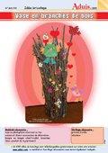 Vase avec branches et brindilles de bois