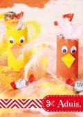 Kleurrijke gevederde vogels gemaakt van wc-rollen